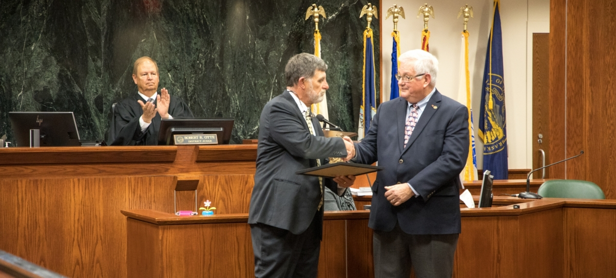 Ed Malk receiving award