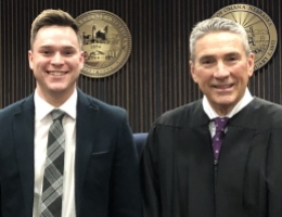 Photo: Problem-Solving Court Judge Tom Otepka (right) with December graduate.