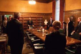 Chief Justice Heavican shows the consultation room to senators