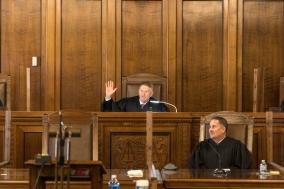 Heavican administers oath